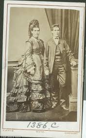 Edward photographed dressed in male and female attire. The photo was edited to make it appear that the two Edwards are standing alongside themselves.